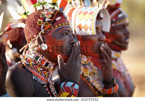 ARCHERS POST - KENYA - JANUARY 14, 2015: Unidentified Samburu warriors singing at a wedding ceremony on January 14, 2015 in Archers Post, Kenya.