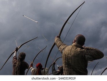 Archers shooting a Volley at a Target