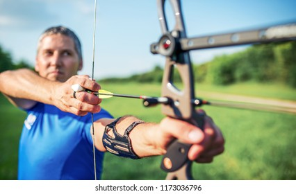 Archery. Archer exercise with the bow. Sport, recreation concept