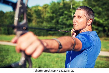 Archery. Archer exercise with a bow. Sport, recreation concept