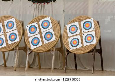 Archery targets full of arrow head holes