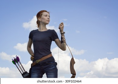 Archery woman with a bow in the summer field