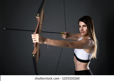 Archery woman on black background
