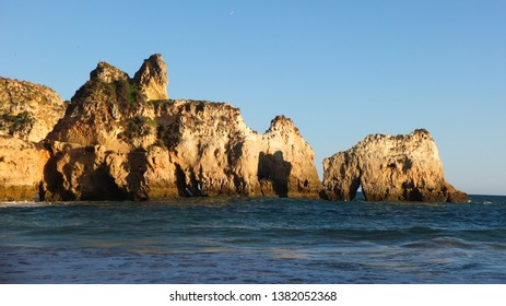 Arches in the cliffs of Algarve coastline, Alvor Beach, Praia dos Tres Irmaos, Portugal