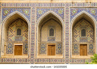 Arches of the entrances to the cells in the madrasah in Samarkand, Uzbekistan