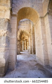 arches in hall of old amphitheater in Tunisia