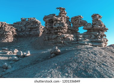 Arches and holes appear among the spires and hoodoos in the gray gilsonite sandstone of Fantasy Canyon, a tiny collection of some of the rarest geologic features in the world, in central Utah, USA.