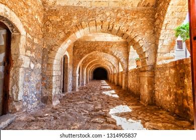 Arches of long niche. Arkadi monastery - Crete, Greece.
