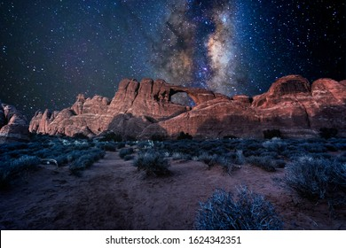 Arches National Park under a milky way star filled night sky in Moab, Utah USA.