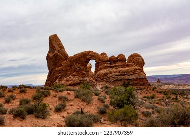 Arches National Park, Utah, USA. Turret Arch. Sandstone fin featuring large & small openings & a taller, turret-like rock pillar to the side.