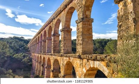Arches of the old stone Roman aqueduct in Tarragona, Catalonia, Spain.