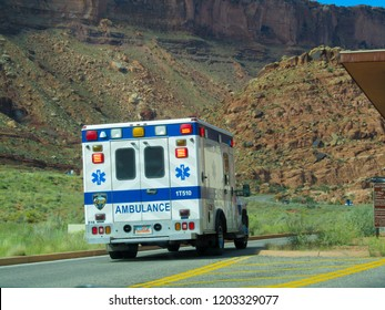 ARCHES PARK, UTAH, SEPTEMBER 21, 2014: Ambulance passing the entrance of the Arches Park in Utah