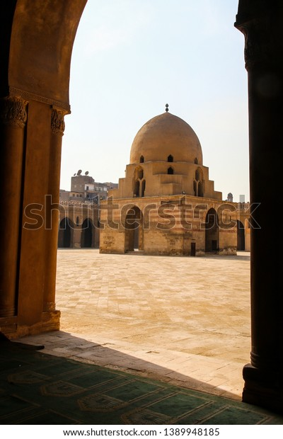 Arches and Plaza of the historic Ibn Tulun Mosque in Cairo, Egypt