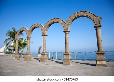 The arches of Puerto Vallarta Mexico over looking the crystal blue water with the Angel in background