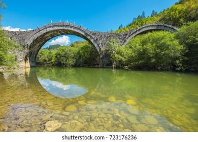 Arches stone bridge of Kalogeriko (or Plakida) on the river of Voidomatis. Central Zagoria, Epirus, Greece