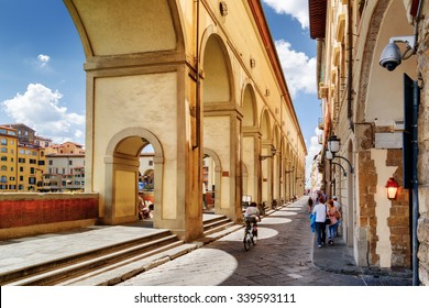 Arches of the Vasari Corridor (Corridoio Vasariano) in Florence, Tuscany, Italy. View of the Lungarno degli Archibusieri. Florence is a popular tourist destination of Europe.