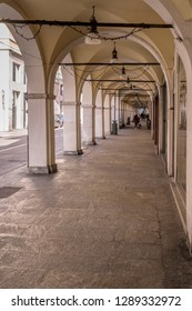 arches and vaults of covered walkway in town center, shot in bright winter light  at Brescia, Italy