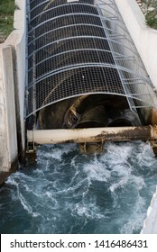 Archimedean screw turbine generating electric energy from the water power of as river. Mini hydroelectric, renewables