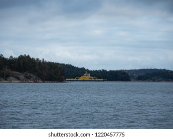 "Archipelago / Finland - 10 20 2018: Traveling in the Finnish Archipelago on a ferry. ""Elektra"", diesel-electric hybrid ferry leaving harbor seen from a distance."