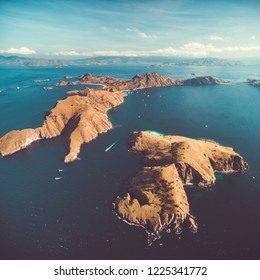 Archipelago, islands, ocean. Komodo. Aerial drone shot. Magnificent panoramic overview the group of the islands of Komodo National Park surrounded by the Pacific ocean. Indonesia.