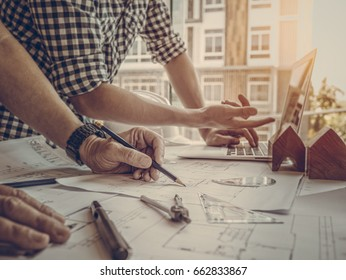 Architect concept, Architects working with blueprints in the office, Vintage Effect, Soft focus