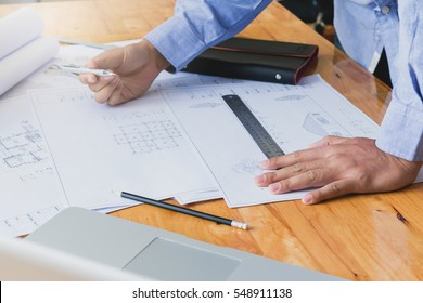 Architect concepts, Architect working with blueprints in the office