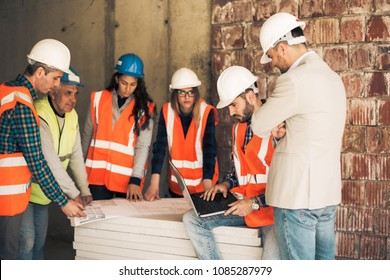 Architect and consruction workers on a construction site