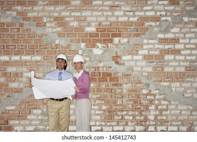 Blueprint spain images stock photos vectors shutterstock architect and construction manager reading blueprint against brick wall malvernweather Images