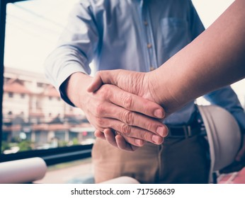Architect and customer shaking hands at workplace. Engineer handshaking with partner for successful deal in building project development. business teamwork, cooperation, success collaboration concept