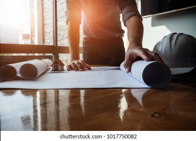 Architect design concept. Young engineer drawing of house structure on blueprint to present Customer. Engineering concept.