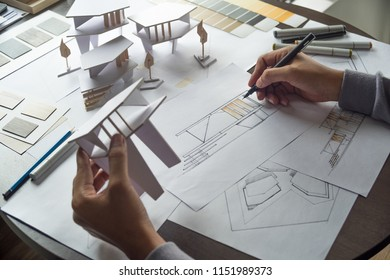 architect design working drawing sketch plans blueprints and making architectural construction architecture model in architect studio