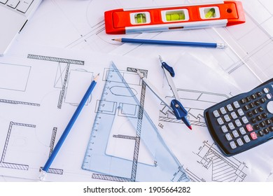Architect design working drawing sketch plans blueprints and making architectural construction model in architect studio, flat lay.