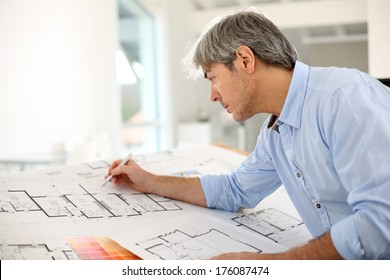 Architect designing house for client