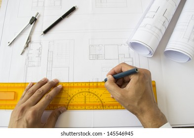 architect designing a plan of a house