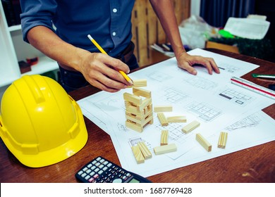 Architect designing  project on the desk in construction site.concept