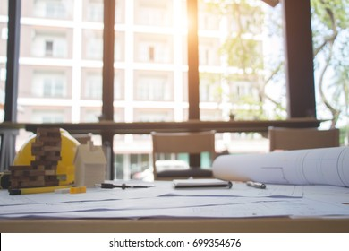 Architect desk, Business,engineering concept,construction site, working with blueprints in the office. Home Project to Offer Management