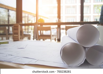Architect desk ,Business,engineering concept,construction site, soft focus, vintage tone, working with blueprints in the office.Home Project to Offer Management