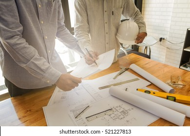 Architect discuss with engineer about project in office, architectural concept