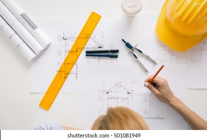 Architect drawing blueprints. Architectural/engineering concept