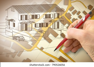 Architect drawing a duplex residential building over an imaginary cadastral map of territory with buildings, fields and roads