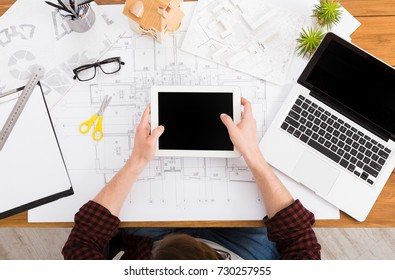 Blueprint paper blank stock photos images photography shutterstock architect drawing on architectural project on digital tablet top view on unrecognizable designer hands working malvernweather Choice Image
