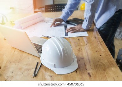 architect drawing on blueprint architectural concept with soft focus