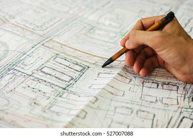 Architect draws a sketch. The construction project. Working space.