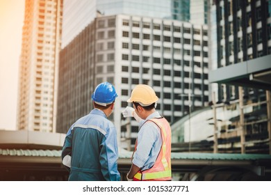 architect and engeneer on construciton site,Construction manager and engineer working on building site