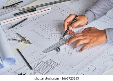 Architect engineer contractor design working drawing sketch plan blueprint and making architectural construction house building in architect studio.                              - Shutterstock ID 1668723253