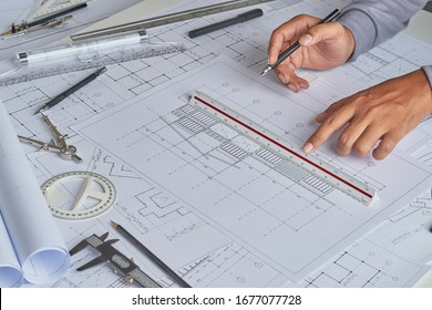 Architect engineer contractor design working drawing sketch plan blueprint and making architectural construction house building in architect studio.