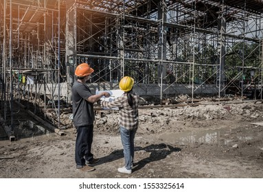 Architect and engineer discuss in building construction site.