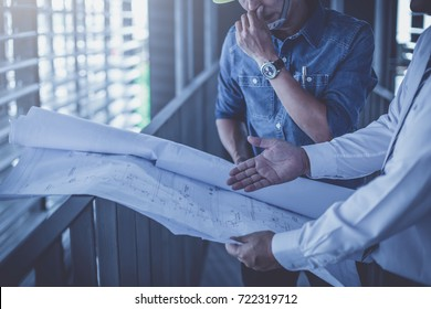 architect and engineer inspect housing estate building to success construction plan before send quality housing to customers ; smart team discuss and review construction plan