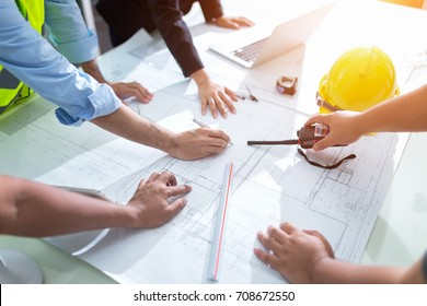 architect and engineer meeting Planning for a New Project with construction equipment on table