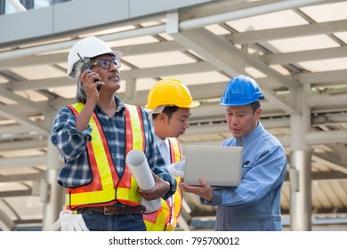 Architect, engineer, project manager or businessman point to building in the city with a blank plan as for construction / Senior engineer man talking on CB phone.